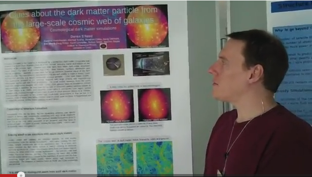 "Darren Reed presents his poster on ""Clues about the dark matter particle from the large-scale cosmic web of galaxies"""